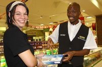 Vincent assists shopper Melinda van Tonder.