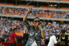 Nhlanhla Nciza from Mafikizolo, wearing her signature glasses, entertains the crowd - Universal Church of the Kingdom of God