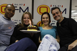 Tim Thabethe, host, Yvette Johnson, news reader, Leanne Nel, sport presenter, and Andre Kunz, producer enjoying their breakfast club cake.(Picture: Sabrina Dean)