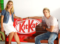 L to R: Kirsten Randall, national sales manager and Brandon Whitehead, media consultant of Campus Media on the branded Kit Kat bench