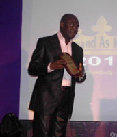 Dan Oshodin, CEO of TMKG, recieving the award