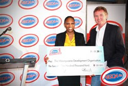 Thuli Mtila (Human Resources and CSI Representative of Algoa FM) handing the cheque for R100 000, proceeds from the 20th Annual Algoa FM Charity Golf Day 2012, to Fr. Jerry Browne (Chairperson of the Board of Directors of the Masinyusane Development Organisation)