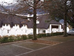 "The thatched roof gives Le Franschhoek Hotel & Spa an inviting ""cottagey"" look."