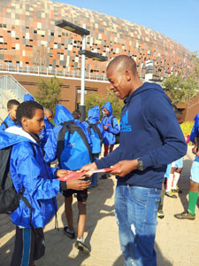 Happy Jele giving his autograph to his young fan
