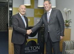 Rudi Jagersbacher, president, Hilton Worldwide, Middle East & Africa and Jan Van Der Putten, vice president of operations, Hilton Worldwide, Africa & Indian Ocean officially open the regional office in Sandton, Johannesburg.