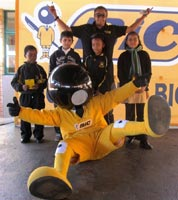 BIC mascot 'BIC Boy' and brand ambassador hand-over prizes to learners.