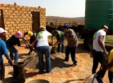 BMi Research staff enjoying the day in the sun while making bricks for Ubuhle Day Care Centre