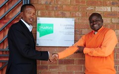 Trudon Managing Director Thabo Seopa and Kwena Molapo High School Prinicipal Michael Maligana