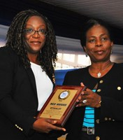 L-R: Biola Edun receives the NCC Award for Excellent Service and effective Collaboration with the Consumer Affairs Bureau to ensure access to Customer Care Help line from Biodun Olujimi.