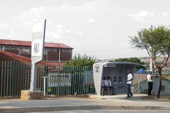 Commuters in Alexandra using the shelter