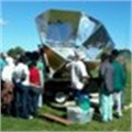 Rotary turn up the heat by donating solar oven to TSiBA Education