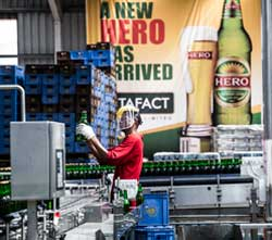 An employee at the Onitsha brewery in Nigeria checks a batch of beer. Image: SABMiller