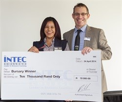 R10,000 bursary winner, Celeste' Bloem is seen receiving her cheque from the general manager for INTEC College, Martin Koch.