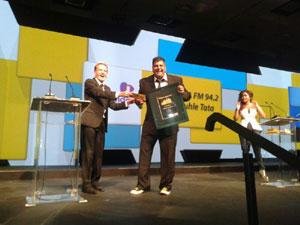 Jacaranda FM Programme Manager Naveen Singh accepting the Multichannel Award for 'Lala kakuhle Tata' - Jacaranda 94.2 FM