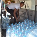Tholang Maphabole from Shoprite Aliwal North assisting with last week's water donation.