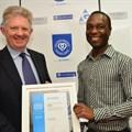Neville Otuki (right) accepting his award last year