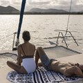 Sunbathing on catamaran A