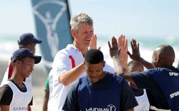 Chairman of the Laureus Sport for Good Foundation South Africa, Morné du Plessis shares a smile of support with young future leaders