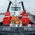 The crew of MVEZO onboard the tug prior to her departure from the Port of Durban.