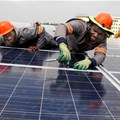 Installing solar panels on Emperors Palace rooftop