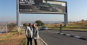Mzukisi Deliwe of Airport Ads® stands with Claudia Vianello of Lanseria International Airport