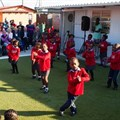 Learners of the Khululeka Early Childhood Development (ECD) Centre dancing in celebration of their newly upgraded facility thanks to the Rotary Club of Claremont's Injongo Project, in partnership with the Lewis Group. [Photo credit: Slingshot Media]