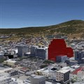 The proposed development with the Bo-Kaap neighborhood and Signal Hill behind it. Image source: