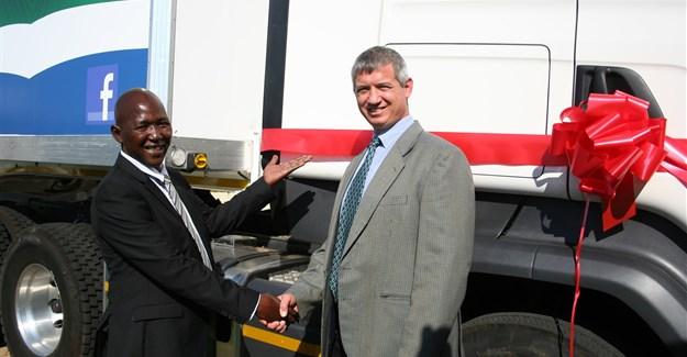 Meshack Matswi, an owner driver, with Tobie Krige, Adcock Ingram's MD: distribution.