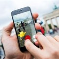 A picture shows a man using the 'Pokemon Go' augmented reality mobile phone app in front of the Brandenburg Gate in Berlin, Germany on Wednesday.