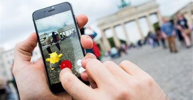 A picture shows a man using the 'Pokemon Go' augmented reality mobile phone app in front of the Brandenburg Gate in Berlin, Germany on Wednesday. Picture: