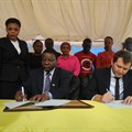 The Permanent Secretary in the Ministry of Communications, Works and Infrastructure, Prof Faustine Kamuzora (seated, left) and Tigo chief commercial officer, Shavkat Berdiev (seated, right), sign a Memorandum of Understanding in which Tigo will provide internet access to Tanzania's secondary schools through the e-Schools Project.