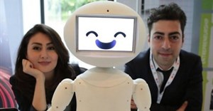 LuxAI's robot with Aida Nazariklorram, co-founder and chief medical officer, and Pouyan Ziafati, founder and CEO.