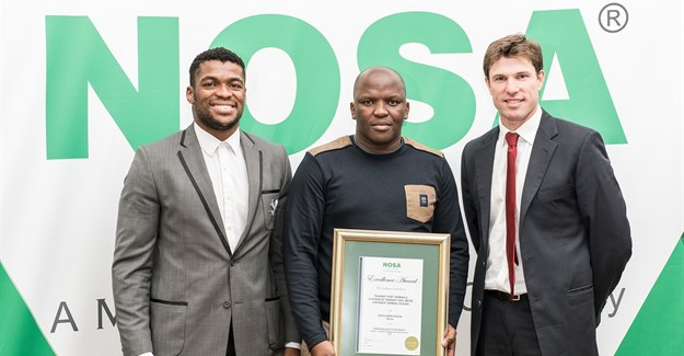 Recipient of the NOSA award in the middle, Vuyani Mtati, SHEQ Manager PE, received six awards.