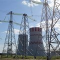 Pylons carry electricity power lines past cooling towers at the Novovoronezh NPP-2 nuclear power station, operated by OAO Rosenergoatom, a unit of Rosatom, in Novovoronezh, Russia. Picture:
