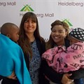 Juanita van Zyl, owner of Shalom Orphanage, Patricia Sefuthi, Heidelberg Mall marketing officer, and children from Shalom Orphanage.