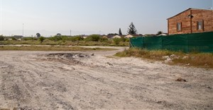 Eight years after a commitment to build houses there, the Thembokwezi site in Khayelitsha is still empty. Photo: Ashraf Hendricks