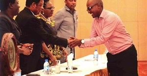 Paul Muhato, Managing Director of Engen in Tanzania shakes hands with the Prime Minister of Tanzania.