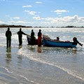 Octagon via  - Fishermen selling their catch of the day at the beach of Paternoster, Western Cape