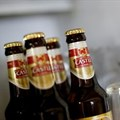 Bottles of SABMiller's flagship brew, Castle Lager, at a bar in Cape Town. Almost 120 years after first listing, its name will disappear from the JSE board this week. Picture: