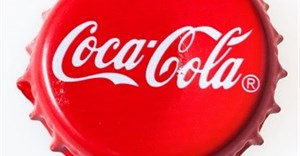 Coke signs at schools 'encourage sugar use'
