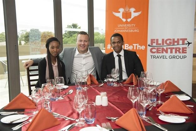 From L-R: Trishia Tshandu, UJ Student and bursary recipient; Andrew Stark, Managing Director, Flight Centre Travel Group; Neo Malema, UJ Student and bursary recipient.