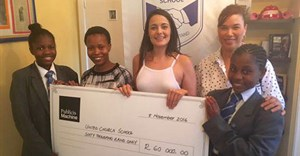 Photo L to R: Blessed Masunika with Monica Maloka and Roxanne Creamer of Publicis Machine, and Headmistress Helene Ullster flanking Ipithule Ndlovu on the far right.