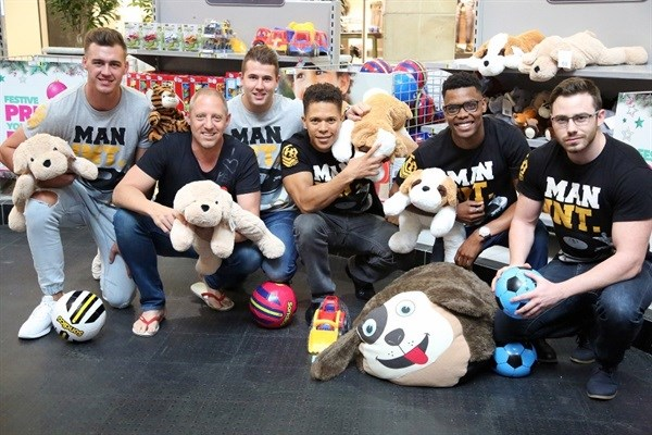 East Coast Radio's Damon Beard and the Man International Models at the East Coast Radio Toy Story with Game Corporate Day Challenge.
