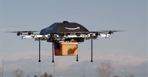"An Amazon picture of a flying ""octocopter"" mini-drone that would be used to fly small packages to consumers ()"
