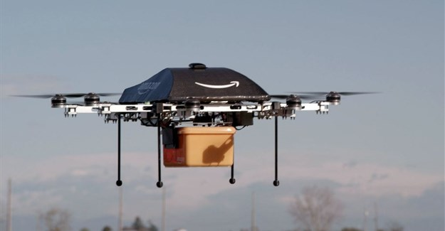 """An Amazon picture of a flying """"octocopter"""" mini-drone that would be used to fly small packages to consumers ()"""