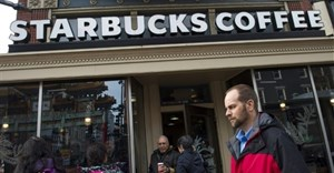 Starbucks plans to hire 10,000 refugees worldwide over the next five years in response to President Donald Trump's travel ban, the head of the US coffee-chain company said | © AFP/File |