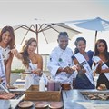 Ronald Ramsamy, Group Executive Chef at Sun International with some of the Miss SA finalists copy