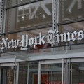 The New York Times and Spotify new subscription service will cost users $5 a week in the US ()