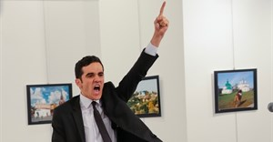 Mevlut Mert Altintas shouts after shooting Andrei Karlov, the Russian ambassador to Turkey, at an art gallery in Ankara, Turkey on 19 December 2016. Picture: Burhan Ozbilici,