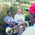 Hanekom enjoys some local music with business owner and community member Sienna Charles on the Dwars River Escape Route. Image: Open Africa